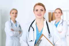 Group of medical doctors standing at hospital. Team of physicians ready to help patients. Medicine and health care. Concept royalty free stock photo