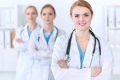 Group of medical doctors standing at hospital. Team of physicians ready to help patients. Medicine and health care royalty free stock image