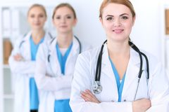 Group of medical doctors standing at hospital. Team of physicians ready to help patients. Medicine and health care. Concept royalty free stock images