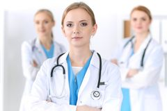 Group of medical doctors standing at hospital. Team of physicians ready to help patients. Medicine and health care stock image