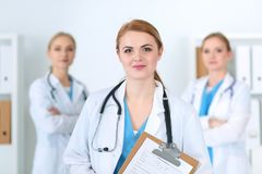 Group of medical doctors standing at hospital. Team of physicians ready to help patients. Medicine and health care. Concept royalty free stock photos