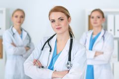 Group of medical doctors standing at hospital. Team of physicians ready to help patients. Medicine and health care. Concept royalty free stock image