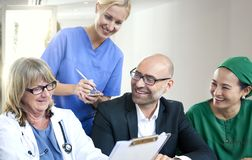 Group of medical people having a meeting stock photos