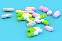 A Group of Medical Pills on a blue background Royalty Free Stock Photo