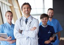 Group of medical staff at hospital. Doctors team standing together Stock Images