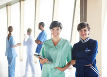 Group of medical staff at hospital. Doctors team standing together Stock Photo