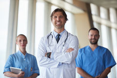 Group of medical staff at hospital, handsome doctor in front of. Team, people group  standing together in background Royalty Free Stock Images