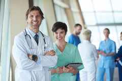 Group of medical staff at hospital, handsome doctor in front of. Team, people group  standing together in background Stock Photography
