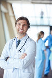 Group of medical staff at hospital, handsome doctor in front of Royalty Free Stock Photos