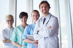 Group of medical staff at hospital, handsome doctor in front of. Team, people group  standing together in background Stock Photo