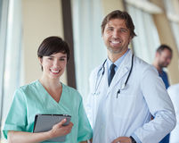 Group of medical staff at hospital, handsome doctor in front of. Team, people group  standing together in background Stock Image