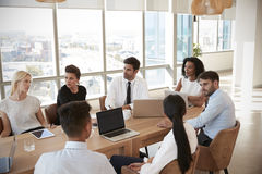 Group Of Medical Staff Meeting Around Table In Hospital stock photo