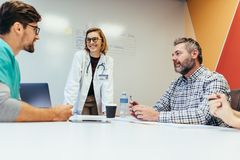 Group of medical staff in a meeting. Team of healthcare workers discussing in boardroom Royalty Free Stock Photos