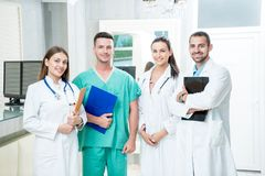 Group of medical staff smiling at the hospital. Holding files Stock Photo