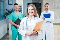 Group of medical staff smiling at the hospital. Holding files Royalty Free Stock Photography