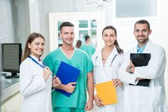 Group of medical staff smiling at the hospital. Holding files Royalty Free Stock Images