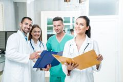 Group of medical staff smiling at the hospital. Holding files Royalty Free Stock Photos