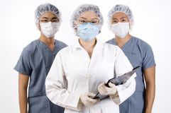Group Medical Team. A group of three young medical professionals Royalty Free Stock Photo
