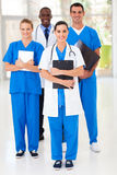 Group medical workers. Group of medical workers full length portrait in hospital stock photo