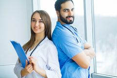 Group of medical workers working together in hospital.  royalty free stock image