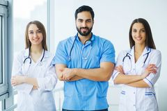 Group of medical workers working together in hospital.  royalty free stock images