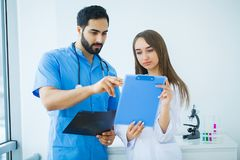 Group of medical workers working together in hospital.  stock photo