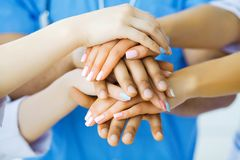 Group of medical workers working together in hospital.  royalty free stock photo