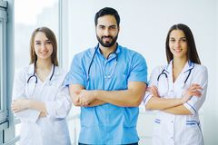 Group of medical workers working together in hospital.  royalty free stock photography