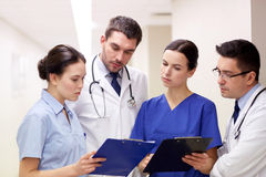 Group of medics at hospital with clipboard Royalty Free Stock Image