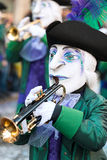 Group of medieval masks at Fasnacht Festival Basel, Switzerland. Group of medieval masks in green and purple costumes playing trumpet at Fasnacht Festival Basel royalty free stock photo