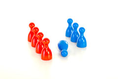 Group of meeples bullying meeple at workplace Stock Photos