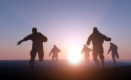 A group of men. Running in from the sun Royalty Free Stock Photo