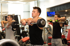 Group of men with barbells in gym. Sport, fitness, lifestyle and people concept - group of men with barbells in gym Stock Photography