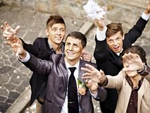 Group men catch  bride  garter Stock Photos