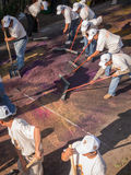 """Sweeping up. A group of men clean up one of the """"alfombras"""" or street carpets following one of the easter (Semana Santa) religious processions in Antigua Stock Photo"""