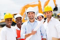 Group of men at a construction site Stock Image