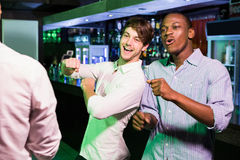 Group of men dancing near bar counter Stock Photography
