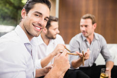 Group of men discussing Royalty Free Stock Image