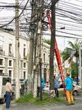 A group of men fixing cables in street of Manila royalty free stock photos