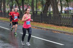 Group of men following woman during 21 km distance of ATB Dnipro Marathon in Dnipro city royalty free stock images