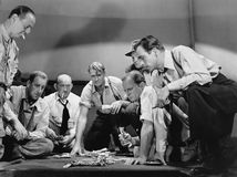 Group of men gambling Stock Photo