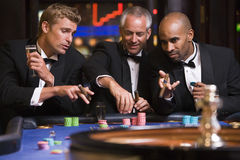 Group of men gambling at roulette table Royalty Free Stock Photo