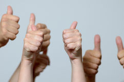 Group of men giving thumbs up gestures Royalty Free Stock Image