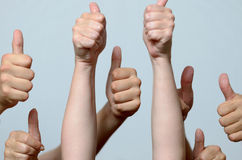 Group of men giving thumbs up gestures Stock Photography