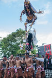 Group of men holding traditional sculpture. Nyepi ceremony in Ba Stock Photos