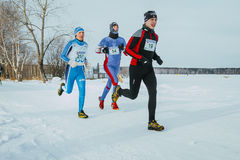 Group of men, leaders race running along shore frozen lake Royalty Free Stock Photo