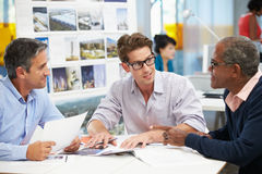Group Of Men Meeting In Creative Office Stock Photos