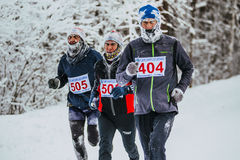 Group men middle age runners running in cold weather in forest Royalty Free Stock Images