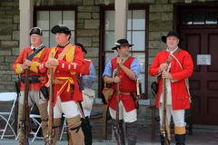 Group of men in military uniforms during re-enactment, Fort Ontario, New York, 2016 Royalty Free Stock Image