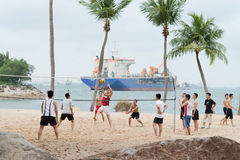 Group of men play volleyball on beach Royalty Free Stock Images